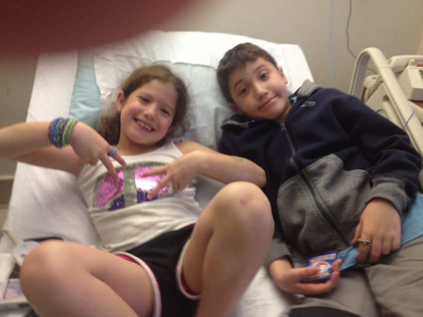 KIds enjoying Spongebob even in a hospital bed